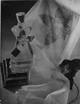 Publicity for fashion and perfume label Maggy Rouff, Paris